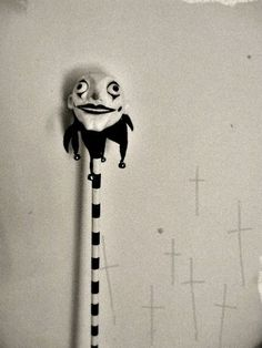Jester's stick belonging to actor James Fontain, used for his role as Hop-Frog in Poe's story. In 1922 he died in a freak accident onstage. It is said the prop is cursed and it is pictured here with crosses that appeared on the wall of his home after the death of seven family members. (This story is edited down from the one accompanying this photo.)