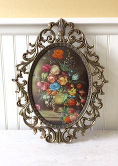 This is a beautiful large brass/metal oval frame with convex glass. Ornate scroll frame design with floral picture. Back has velvet lining & metal ring for hanging. In very good vintage condition! Great for so many home decors. Could be painted white for more of a shabby chic look, or for wedding decor. Measures 13.5 H. X 10.5 W. Fits 9.5 x 7 picture Thanks for shopping YellowHouseDecor!  Please visit my sisters shop for more vintage frames (ellansrelics02)