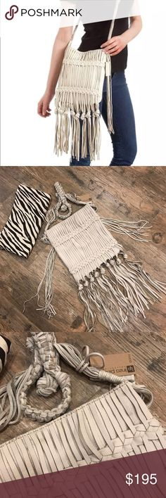 Linea Pelle Daisy Fringe Crossbody NEW LINEA PELLE FRINGE CROSSBODY BAG CHOOSE BY MANY CELEBRITIES LIKE  VANESSA HUDGENS - DEMI LOVATO  Sand Cream suede crossbody with brass hardware, fringe details, and woven accents  Can hold a wallet, cell phone, essential cosmetics, a set of keys, and sunglasses  Approximately 9in at widest point x 10in high x 1in deep  Woven and knotted fringe suede shoulder strap has a 20in drop  Open top with magnetic closure  Beige and brown zebra print fabric lining…