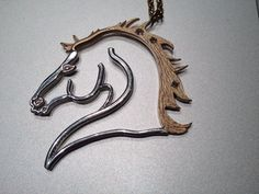 Equestrian Fine Jewelry designed by Donna B Textured gold mane accented with three diamonds - polished  sterling silver design