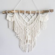 Large Macrame Wall hanging  A fusion knots and of course lots of fringing! The star of this piece is a beautiful long branch.  Your piece is made by hand using natural unbleached cotton and revived branches from local woods in Upstate NY and the Adirondacks. ✨✨✨  SIZING She measures roughly 35in x 30in (including the branch) so she is sure to stand out wherever you choose to hang her.  Sizing is approximate: Branch Width - 35 Macrame Length - 25 Rope hanger- 20 (adjustable)  ✨✨✨  MADE TO…