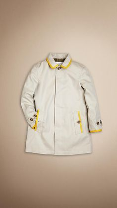 Burberry Boys. Gabardine with contrast leather trim.  Fly-front button closure.  Adjustable button-tab cuffs.  Button-through pockets.