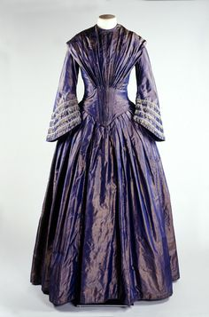Bronze shot silk dress with bell shaped sleeves; c. 1849-1850