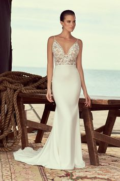 Style 2190 | Guipure #Lace and Crêpe #WeddingDress. V-neckline bodice in Guipure Lace lined with Nude Italian Tulle and Crêpe piping around neckline. Crêpe belt at waist. Fit and flare Crêpe skirt.