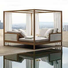 Clean, architectural teak lines frame the Brizo Daybed-whose inner spaces are defined by cloud-like curtains and airy, rope-like strands of wicker. The    enclosed facing chaises each recline in four t--t positions. A poem in solidity, space  and connection. White all-weather    wicker, tailored cushions with high-resiliency foam core. Privacy panels are sewn from Sunbrella high-performing solution-dyed fabric.            Daybed chaises recline to four positions on opposite ends, allowin...