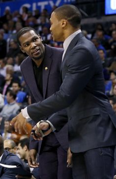 Injured Oklahoma City players Kevin Durant, left, and Russell Westbrook talk during an NBA basketball game between the Oklahoma City Thunder and the Detroit Pistons at Chesapeake Energy Arena in Oklahoma City, Friday, Nov. 14, 2014. Photo by Nate Billings, The Oklahoman