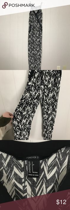 Jumper Forever 21 black and white printed jumper with pockets and adjustable straps the front of it clasps shut Pants