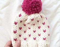 ** KNITTING PATTERN ONLY ** to knit a Timber Toque  Sizes: Baby ages 1-4 (Child ages 5-10 , Adult ages 11 and on )  Skill level: Intermediate  Materials, notions, and useful things you will need:   2 balls of Lion Brand Wool Ease Thick and Quick yarn in contrasting colors or any super bulky ( 6 ) yarn.  6.5 mm ( US 10.5 ) - 16 inch circular knitting needles ( or 4 DPNS ) and 9mm ( US 13 ) -16 inch circular knitting needles ( or 4 DPNS )  Tapestry yarn needle  1 stitch marker Optional - Pom…
