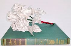 Literary Bouquet made from the Britannica Great Books edition of Galileo's Two New Sciences. https://www.etsy.com/listing/221147434/literary-origami-bouquet-6-roses