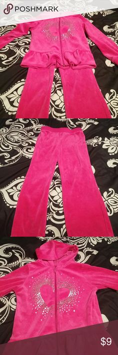 Pink velvet like matching set. NWOT Pink velvet like matching set silver heart design on the front of the zip up jacket and stretchy pants to match. NWOT. Size 4T Matching Sets