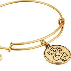 Alex and Ani gold puzzle charm bracelet Alex and Ani gold piece of the puzzle charm bracelet. Worn around 5 times and in great used condition. No flaws. Alex & Ani Jewelry Bracelets