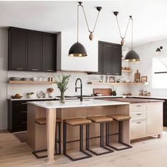 Love the lights, high contrast Designer: . Contractor: Forsythe & Hall Homes Photo: Cosy Kitchen, Home Decor Kitchen, Kitchen Living, Kitchen Interior, Home Kitchens, Neutral Kitchen, Transitional Kitchen, Interior Desing, Kitchen And Bath Design