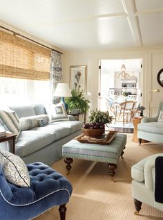 House of Turquoise: Ashley Whittaker Design. Drapes combined with woven wood shades. Furniture arrangement. #design #interiors #living
