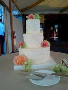 Buttercream with pearl trim and Soft Flower Accents.