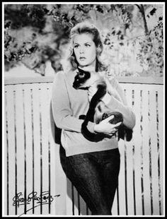 Elizabeth Montgomery, with a siamese cat, on the set of 'Bewitched'.