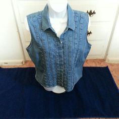 COMING SOON Blue Denim Sleeveless Shirt Blue denim sleeveless button down shirt with lots of pintucking details to decorate the front. Super cute paired with the bottom of your choice. From a pet and smoke free home. Please ask any questions you may have. Tops Button Down Shirts
