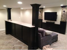 Bar top behind couch. Basement layout.
