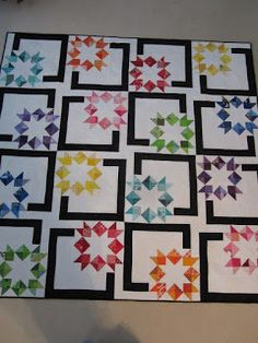 Inverted Star, Quilted and Bound (Sewing Out of My Comfort Zone) Inverted Star is done! I put the last stitch in the binding Friday night. This quilt has a lot of texture thanks to Debbie Cooper's longarming. She suggested the wavy pantograph, which I lov Star Quilt Blocks, Star Quilt Patterns, Star Quilts, Scrappy Quilts, Amish Quilts, Canvas Patterns, Vintage Star, Rainbow Quilt, Texas Star