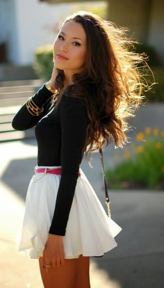 Black sleeve blouse and white flowy mini skirt fashion, love how the light takes over her hair