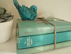 I am loving old books tied together...I've also tied them together with old belts. I love books...