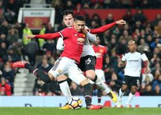 Chris Smalling of Manchester United in action with George Thorne of Derby County during the Emirates FA Cup Third Round match between Manchester...