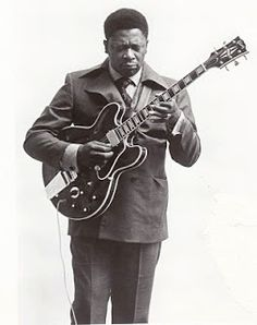 B.B. King, 1964 with a early version of Lucille, a Gibson ES355 that he stuffed the sound holes up to prevent feedback. Today he uses custom ES335's
