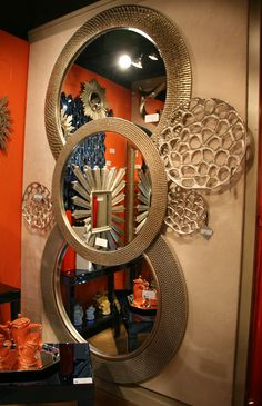 Here are a few of Howard Elliott's textured round mirrors with some new wall art pieces.  High Point 10/2013