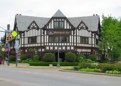 """""""The Mariemont Inn is a hotel located in downtown Mariemont, Ohio, a village located in the Cincinnati suburbs.Established in the 1920s by Mary Emery, Mariemont is one of the earliest planned communities in the U.S., and the European-style architecture of the hotel is similar to that of a number of other buildings in the community..."""" By tcpix on flicker"""