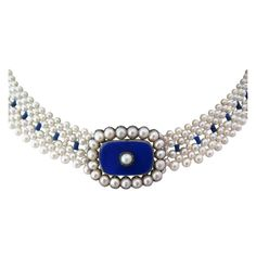 Antique blue enamel brooch has been re-imagined as a centerpiece on this unique one of a kind pearl necklace , by Marina J