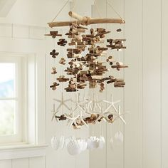 I love the Driftwood + Starfish Mobile on pbteen.com, for Evan's room