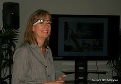 Karen Herman. Founder of Gustie Creative, shows off her Google Glass while giving a presentation about her first experiences while in New York City at the 8/15/13 meeting.