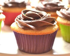 12 Vanilla Cupcakes with Chocolate Buttercream Frosting
