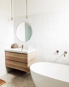Crazy in love with this quiet, yet super sophisticated design by including our Timberline Rod Pendants in brass Neutral Bathroom, Bathroom Inspo, White Bathroom, Modern Bathroom, Small Bathroom, Bathroom Ideas, Bathroom Designs, Beautiful Bathrooms, Bathroom Inspiration