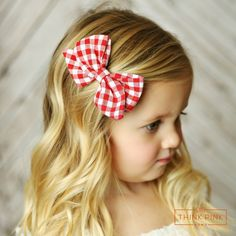 """This cute """"Life's a Picnic"""" clipfeatures a 4"""" bow in a red and white checkedfabric and placed on a simple to open hair clip that she'll easily be able to put on herself. Each bow is hand tied making it secure.SHOP Think Pink Bows summer hair accessories at http://thinkpinkbows.com/products/lifes-a-picnic-boutique-bow-clippie 