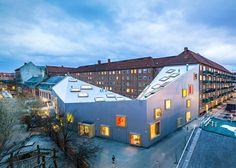 Children's centre with a dipping roof by Dorte Mandrup encloses a Copenhagen courtyard