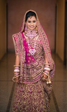 You can never go wrong with a Deep #Pink #lehenga with heavy #Gold work. #Timeless