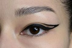 ARTISTIC LINER -- This liner has negative space in the middle of it. It is quite small which makes it more flattering and easy to wear!
