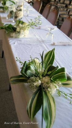 020 aspidistra bow centerpieces | by Rose of Sharon Floral Designs