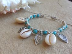 Adjustable Hemp Weaved Bracelet with Cowrie Shells, Leaf Charms and Howlite Turquoise Beads.