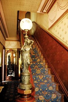 Victorian staircase with a gorgeous statue light Victorian Home Decor, Victorian Lamps, Victorian Interiors, Victorian Architecture, Antique Lamps, Victorian Gothic, Victorian Fashion, Victorian Houses, Victorian Stairs