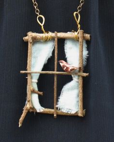 DIY window necklace. This would make a cute window for a fairy garden, too. (idea only, not a direct link)