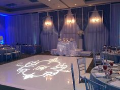 Picture-perfect silver wedding reception decor in the Monte Carlo Ballroom at Chateau Elan Winery & Resort.