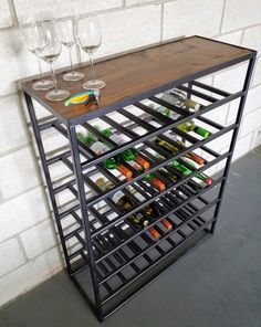 Industrial style wine rack size high wide x deep The steel is finished in graphite grey and the wood is stained warm oak. This 48 bottle wine rack is hand crafted in our UK workshop… Vintage Industrial Furniture, Reclaimed Wood Furniture, Steel Furniture, Bar Furniture, Industrial Style, Furniture Outlet, Italian Wine, Wine Storage, Colorful Furniture