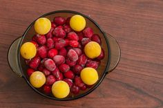 dish with frozen cherry plum and dogwood