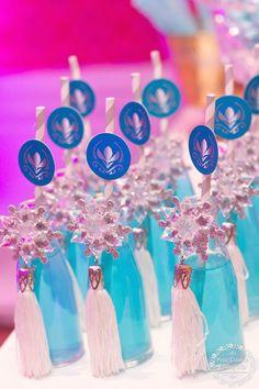 Blue Drinks in Soda Bottles with White Tassles and Frozen Straws