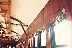 Adore the simple fabric bunting above the windows! Camp Kiwanee Wedding   DIY Vintage Summer Camp Wedding {pinned by theheartstate.com}