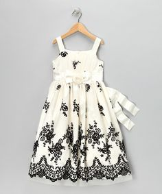 This sweetly sophisticated piece boasts enchanting floral accents, decorative bows and a classic A-line silhouette. A spirited sleeveless design says this dress is ready for the party to begin.