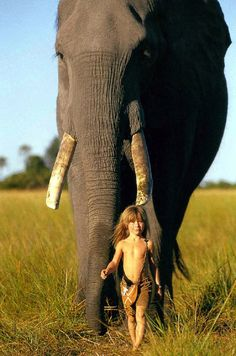 Young girl who is best friends with African wildlife