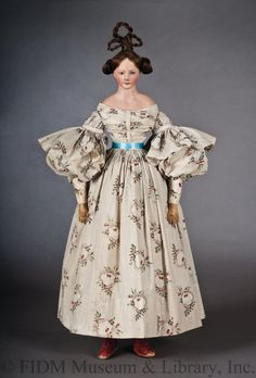 Papier-mâché  Fashion Doll with roller-printed cotton muslin dress, 1835~Image © FIDM: Fashion Institute of Design & Merchandising