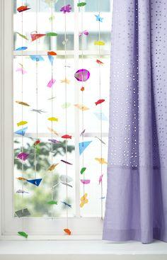 http://blog.landofnod.com/honest-to-nod/2011/12/try-this-colored-cellophane-garland-curtain.html